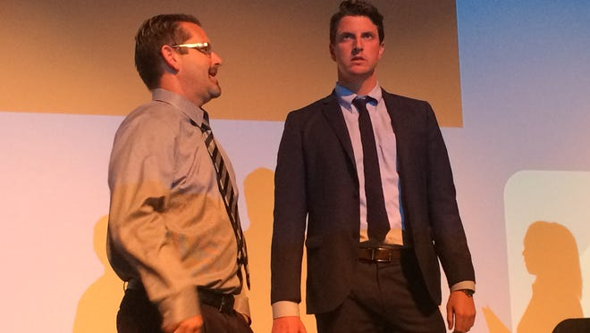 Agoura High School principal Brian Mercer and State Sen. Henry Stern, D-Canoga Park address the more than 100 people who attended Saturday's event at the Agoura Performing Arts Center.