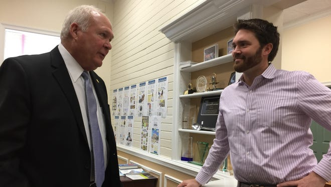 From left, Bert Thornton, retired president and COO of Waffle House Inc., speaks with D.C. Reeves, chief of staff for Studer Family of Companies, on Tuesday, Oct. 17, 2017.