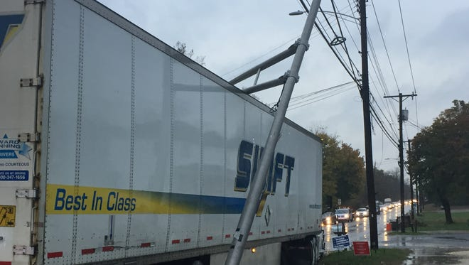 A tractor trailer driver making a turn from Sherman Avenue to Main Road snapped a light standard on Tuesday resulting in traffic delays