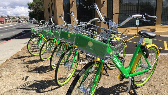 LimeBike cycles parked at Wells Avenue and Ryland Street on Monday, May 14, 2018 in Reno, the first day of the dock-free bikeshare company's service in Reno.