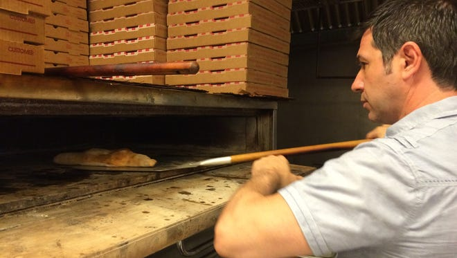 Owner Salvatore Migliore checks on a calzone at Bella Mia Pizza & Restaurant in North Fort Myers. Migliore is opening PrimaFila in downtown Fort Myers.