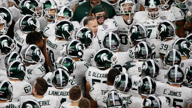 Dec 31, 2015; Arlington, TX, USA; Michigan State Spartans head coach Mark Dantonio speaks to his team prior to the game against the Alabama Crimson Tide in the 2015 CFP semifinal at the Cotton Bowl at AT&T Stadium.