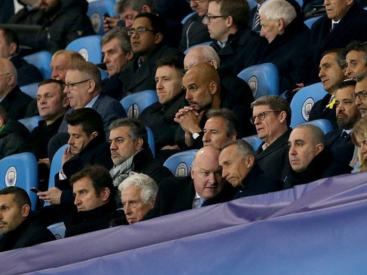 Manchester City manager Pep Guardiola, center, watches from the stands during the  Champions League, quarterfinal second leg soccer match against Liverpool at the Etihad Stadium, Manchester, England Tuesday April 10, 2018. (Tim Goode/PA via AP)