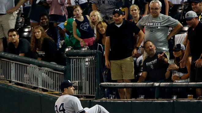 New York Yankees' Dustin Fowler sits on the field after suffering an injury during the first inning of the team's baseball game against the Chicago White Sox on Thursday, June 29, 2017, in Chicago. (AP Photo/Nam Y. Huh)