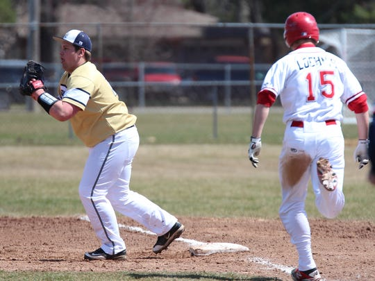 Canton's Andrew Loehnis is unable to beat the throw to Detroit Country Day first baseman Nick Weinerth during Saturday's opening game.