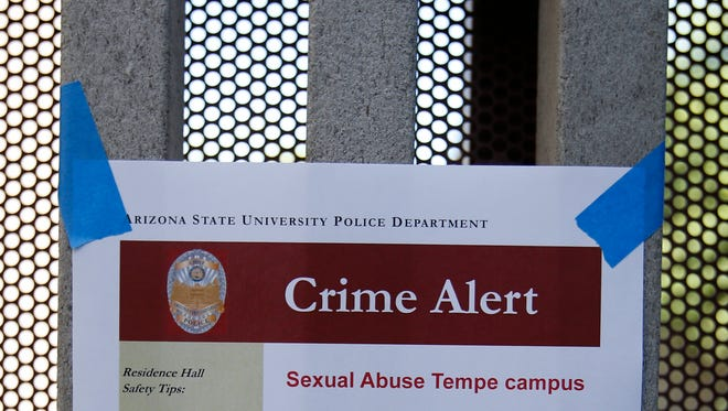 ASU posts signs at the Adelphi II Commons near Apache Boulevard and Rural in Tempe after an sexual assault occurred in September 2014.