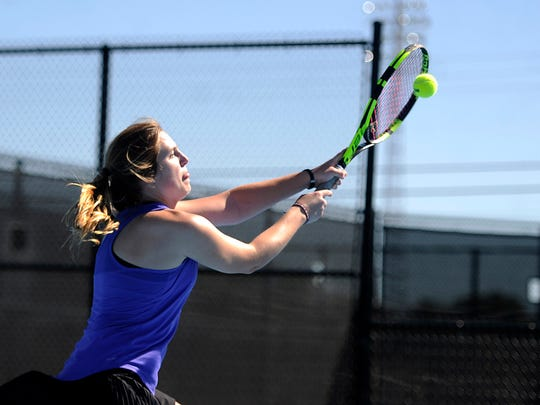 Wylie's Andrea McMillan slams a ball at the net during the mixed doubles championship match with partner Zane McCurley against teammates Spencer Lin and Ashley Smyser in the District 5-4A tennis tournament on Thursday, April 6, 2017, at Hardin-Simmons University's Streich Tennis Center.