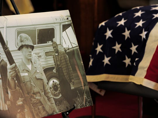 A picture of Matthew Walker passing a National Guard soldier during the Freedom Rides rests next to his casket during his funeral at Clark Memorial United Methodist Church on April 16, 2016, in Nashville, Tenn.