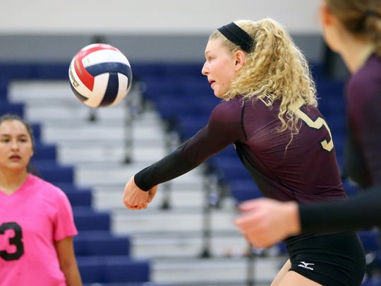 Tuloso-Midway's Bethany Clapp returns the ball against London during the CCISD McDonald's SpikeFest Championship game on Saturday, Aug. 12, 2017, at Veterans Memorial High School in Corpus Christi.