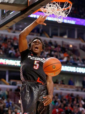 McDonald's West All-American Stanley Johnson dunks the ball against the East All Americans during the first half of the McDonald's All-American boy's basketball game Wednesday, April 2, 2014, in Chicago.