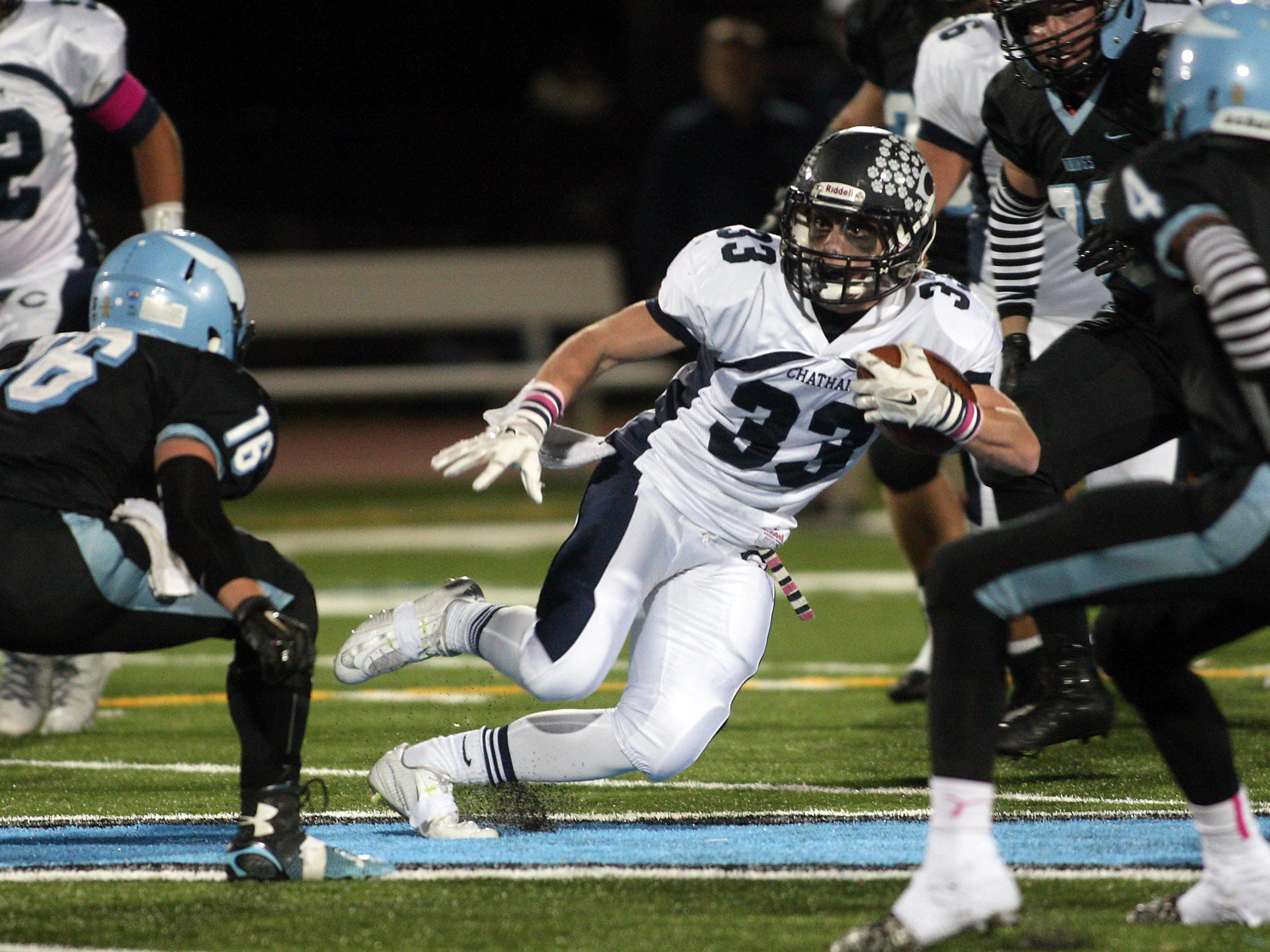 Chatham running backJustin Hayes gains yardage vs defending sectional champion Parsippany Hills in a showdown with playoff implications. October 30, 2015, Parsippany, NJ.