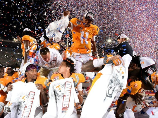 Tennessee quarterback Joshua Dobbs (11) dumps confetti over his teammates as they celebrate their 45-24 win over Virginia Tech in the Battle at Bristol on Sunday, Sept. 11, 2016, at Bristol Motor Speedway in Bristol, Tenn. (MICHAEL PATRICK/NEWS SENTINEL)