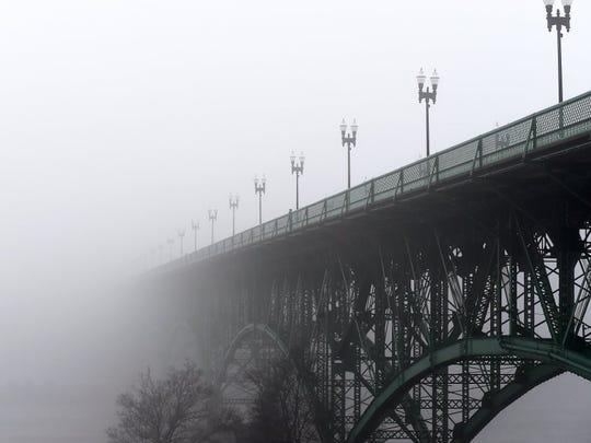 Fog hangs across the Gay Street Bridge. (AMY SMOTHERMAN BURGESS/NEWS SENTINEL)