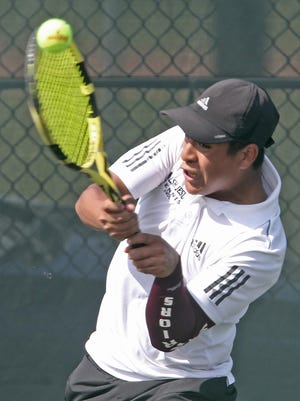 Walsh Jesuit's Caleb Miller returns a serve by St. Ignatius' Arjun Brahmbhatt on Monday in Cuyahoga Falls.