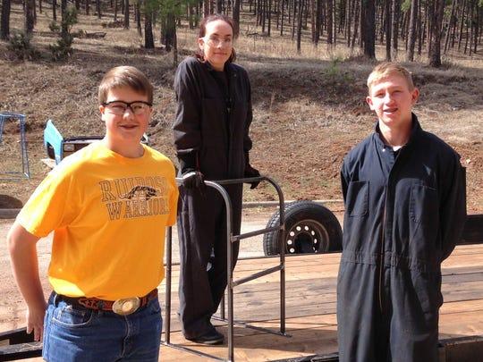 Joshua Mader, Natalie Addis and Brennam Stewart and the walker.