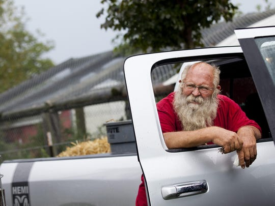 "Chuck Vanneste, chief executive officer, rests on the door of a truck and looks out over the animals Thursday, September 3, 2015 at Summer Wind Farms Sanctuary in Brown City. Vanneste has operated the sanctuary for 25 years. Many of the animals are former mascots, unwanted pets and animals used as photo ops until they grow too large. ""There was no place for these exotics to go,"" Vanneste said. ""We don't believe in euthanization unless it is absolutely necessary."" The farm received 98 citations in 2014 for things such as inadequate bedding, too few trained staff members and rotten meat in the food preparation area."