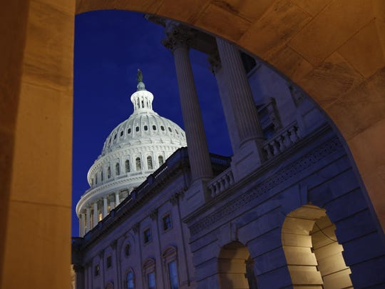 Light shines on the U.S. Capitol dome in Washington, early Wednesday, Dec. 4, 2019, prior to scheduled testimony from Constitutional law experts at a hearing before the House Judiciary Committee on the constitutional grounds for the impeachment of President Donald Trump. (AP Photo/Patrick Semansky)