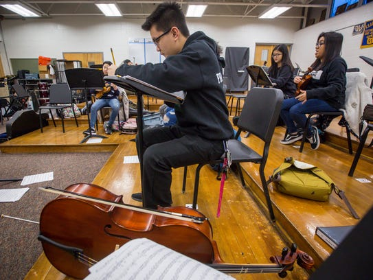 Jonathan Praseutsack looks over his music before chamber