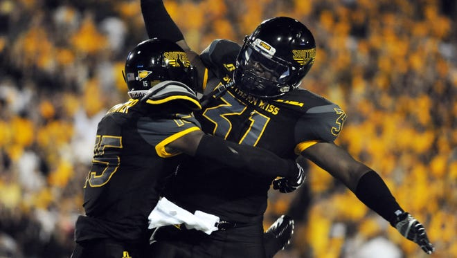 Southern Miss safety Devonta Foster, left, and linebacker Anthony Swain have both missed playing time this season.