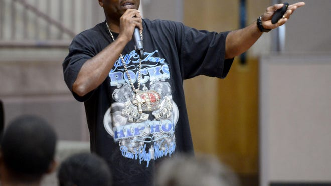 Shawn Jackson, author and founder of the Jaxsun Group, speaks to an audience at the Brownsville Community Center on Wednesday during the Bridging the Gap crime prevention summit hosted by the Escambia County Sheriff's Office. Jackson's program uses Hip Hop culture to connect with youth, give examples of success through hard work and show how to avoid making bad decisions.