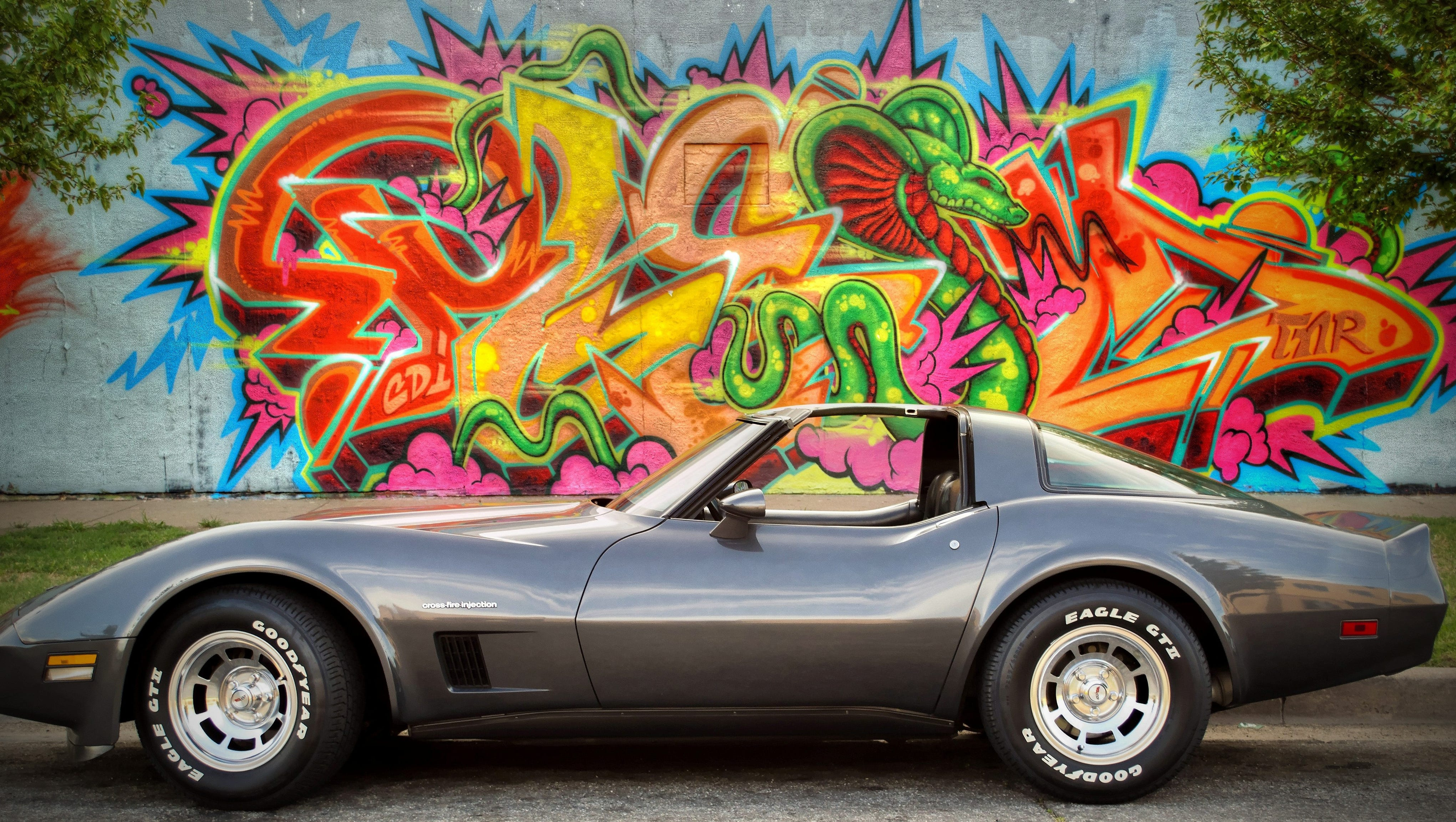 "We're honoring readers' ""Best of Corvettes"" for the Chevy Corvette's 60th Anniversary and the debut of the iconic brand's latest 2014 model. Here is Brad Oliphant's1982 Chevy Corvette pictured outside of a tattoo parlor in Wichita, Kan."
