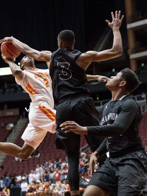Corona del Sol's Saben Lee (2) gets his shot blocked by Cesar Chavez's Malik Porter (3) during their 6A Conference semifinals game on Thursday, Feb. 23, 2017, at Gila River Arena in Glendale, Ariz.