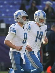 Matthew Stafford (9) and Jake Rudock take the field before playing the Ravens last season.
