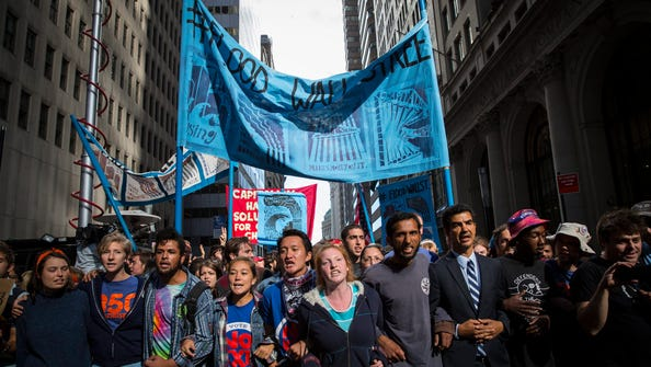 Occupy Wall Street protesters march on Broadway in New York.