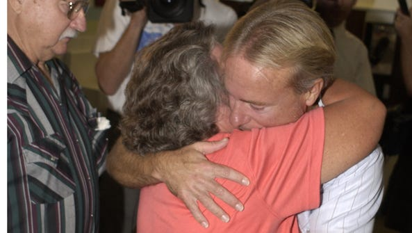 Free at last. Mary and Gary Dedge greet their son,