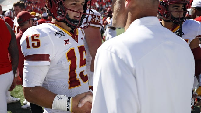 Iowa State quarterback Brock Purdy (15) talks with Texas Tech coach Matt Wells after the Cyclones' 34-24 victory last year at Jones AT&T Stadium. Purdy, only three games into his junior year, already has 21 school records and at least one victory against every other Big 12 team.