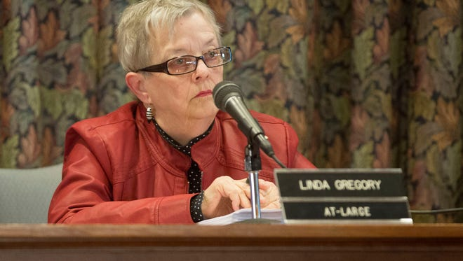 Linda Gregory listens to members of the public during a Muncie City Council meeting.