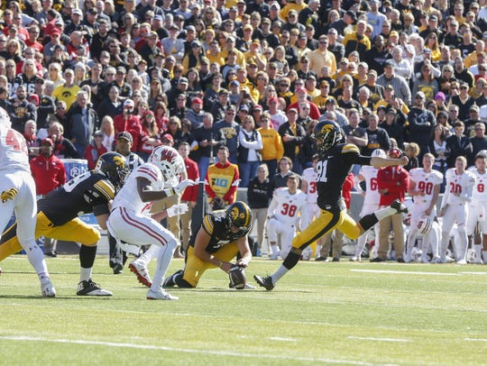Iowa place kicker Miguel Recinos hits a field goal