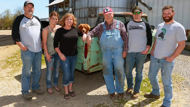 Three generations of the Alexander family gather at the farm, from left, Jeff, Anna, Julie, Larry,  Adam and Andrew.