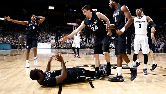 Jan 19, 2016; Providence, RI, USA; Butler Bulldogs guard Kellen Dunham (24) helps forward Roosevelt Jones (on ground) up after Providence Friars guard Kris Dunn (3) was called for an offensive foul during the first half at Dunkin Donuts Center. Mandatory Credit: Mark L. Baer-USA TODAY Sports