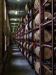 Rows of bourbon barrels age inside a Brown-Forman warehouse