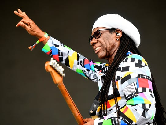 Nile Rodgers waves at the Bonnaroo Music and Arts Festival