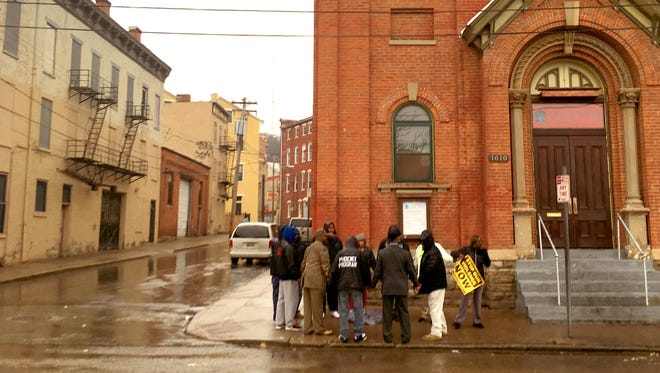 A group met to pray in Over-the-Rhine Tuesday following the fatal shooting of Casey Roby.