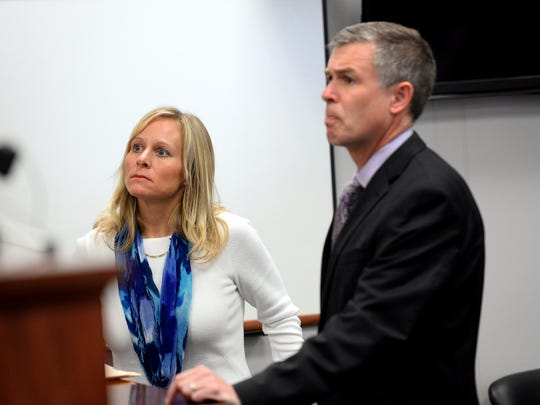 Former state Rep. Cindy Gamrat and her attorney, Mike Nichols, speak with Ingham County District Court Judge Hugh Clarke Jr. Tuesday during Gamrat's arraignment on two felony charges.