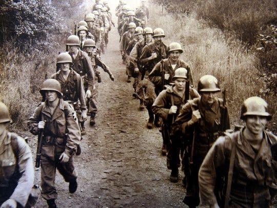 Bob Flory's unit marches in Korea, circa 1950. Flory,