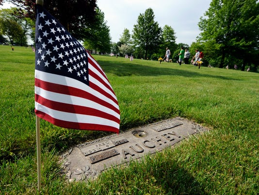PHOTOS: Students place flags for Memorial Day