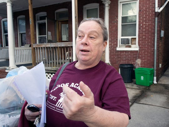 Neighbor Betsy Fields talks about activity at the nonprofit in the past at 20-26 N. State St., on Monday.