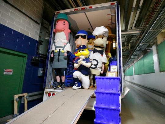 Bernie Brewer, the Milwaukee Brewers mascot, and the Famous Racing Sausages pose for a photo in the back of the truck.