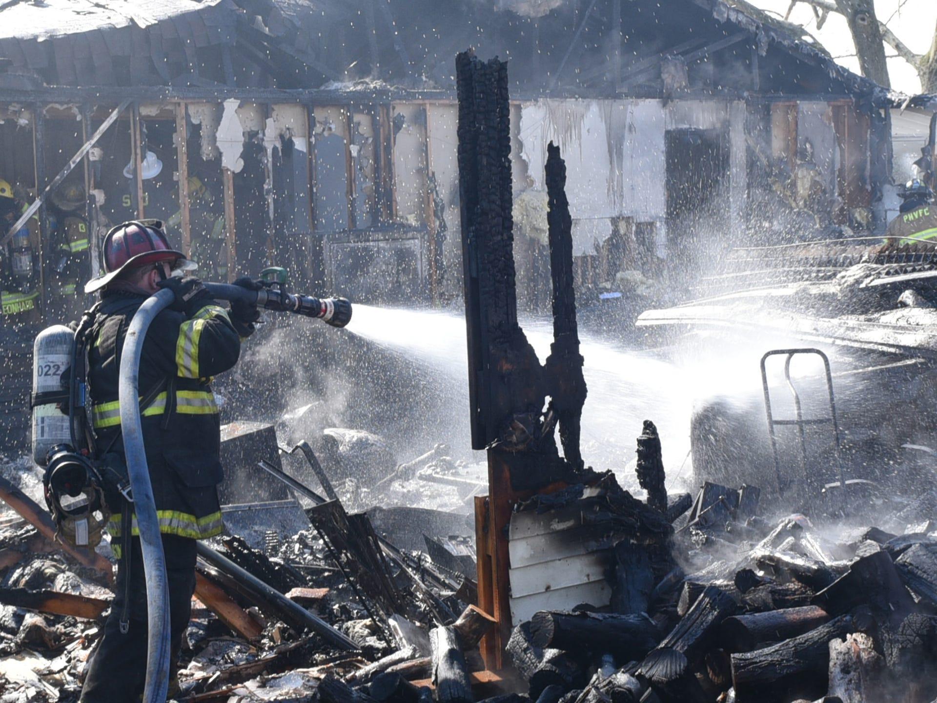 PHOTOS: Fire destroys house garage in Lurgan Township