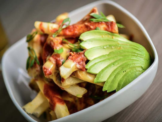 Chili Cheese Fries are among the offerings at the Funky Monk, the newest restaurant concept from Scottsdale-based Square One Concepts.