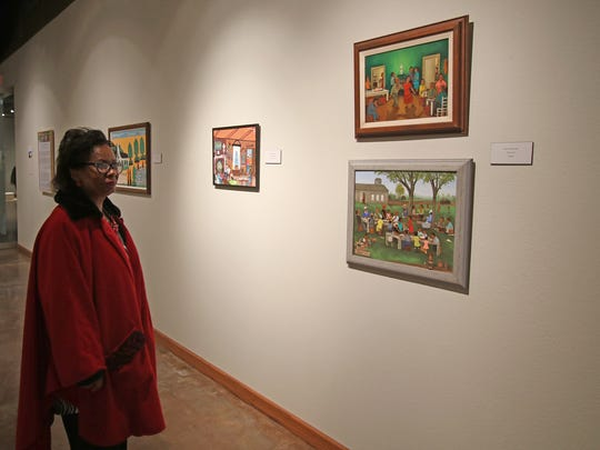"""Evelyn Lewis looks at the art on display before the public reception for """"The Souls of Black Folk"""" Sunday, Feb. 4, 2018, at the Wichita Falls Museum of Art at Midwestern State University."""