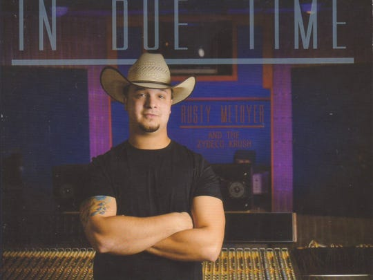 """Submitted photo Rusty Metoyer is shown on the cover of his sophomore CD, """"In Due Time."""" Rusty Metoyer is shown on the cover of his sophomore CD, """"In Due Time."""""""