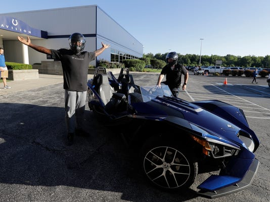 Indianapolis Colts' Vontae Davis reacts after arriving for NFL football training camp in a Polaris Slingshot SL, Saturday, July 29, 2017, in Indianapolis. (AP Photo/Darron Cummings)