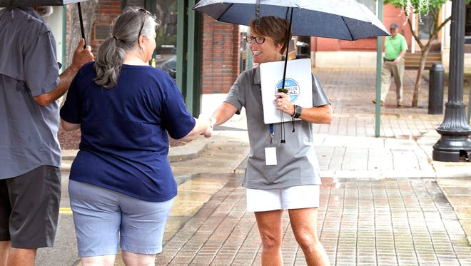 Joni Cole greets tourists walking down Main Street as part of Franklin Locals, a new ambassador program to help tourists with directions or questions during peak hours in downtown Franklin.