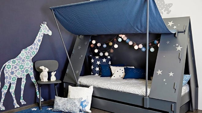 Turn a child's bed into a camp tent with some plywood, slats, poles and a curtain of canvas.