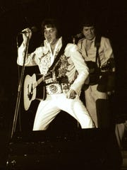 Elvis Presley performs on March 30, 1977, in the Rapides Parish Coliseum. It was one of his final concerts before his death in August 1977.